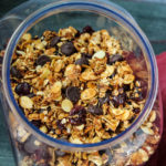 Rich dark chocolate, sweet coconut, and tart dried cherries make this homemade granola shine. Enjoy your indulgent homemade Dark Chocolate Cherry Coconut Granola as cereal, a yogurt topper, or a snack - you won't be disappointed.