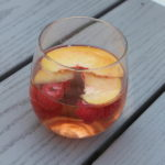 Peach Rose Sangria combines a light rose wine with peach fruit and liquor to create a refreshing summer cocktail that will have you going back for more.
