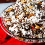 Sweet & Salty Valentine's Popcorn Mix - Salty popcorn and peanuts are drizzled with dark chocolate and topped with sprinkles for a Valentine's Day snack both adults and kids will love!