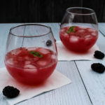 A make ahead cocktail to serve a crowd, this Blackberry Tequila Cooler combines sweet blackberries, tart lime, and bubbly wine for a light and refreshing summer cocktail.