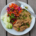 Sweet yet spicy pulled pork, quick pickled vegetables and hearty brown rice is my new favorite summer combo - Slow Cooker Pork Bahn Mi Bowls with Pickled Vegetables. With bright flavors, you don't even need to turn on the oven to enjoy this satisfying meal!