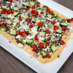 Shake up your appetizer game with this Mediterranean Layer Dip. Healthy, flavorful, and easy, this dip has proven to be a hit, again and again.