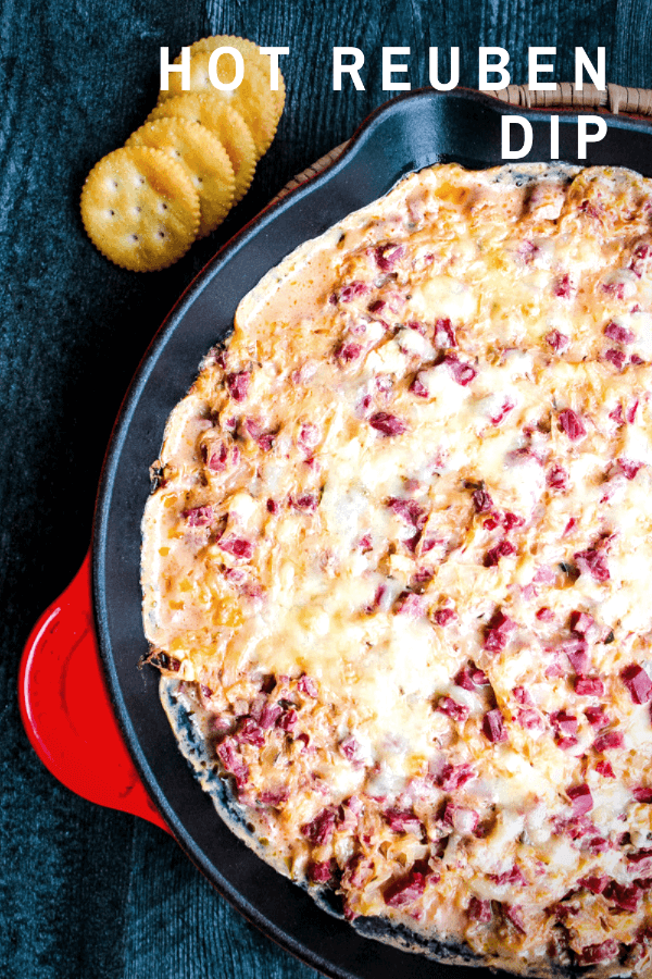 This Hot Reuben Dip tastes just like the sandwich. Corned beef, sauerkraut, Thousand Island dressing and Swiss cheese are mixed together and served piping hot - in a hearty dip great for fall and winter entertaining and game days.