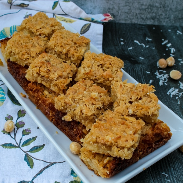 These Coconut Macadamia Nut Bars are an unexpected, bar cookie - a shortbread crust topped with a sweet and salty mix of coconut and macadamia nuts.