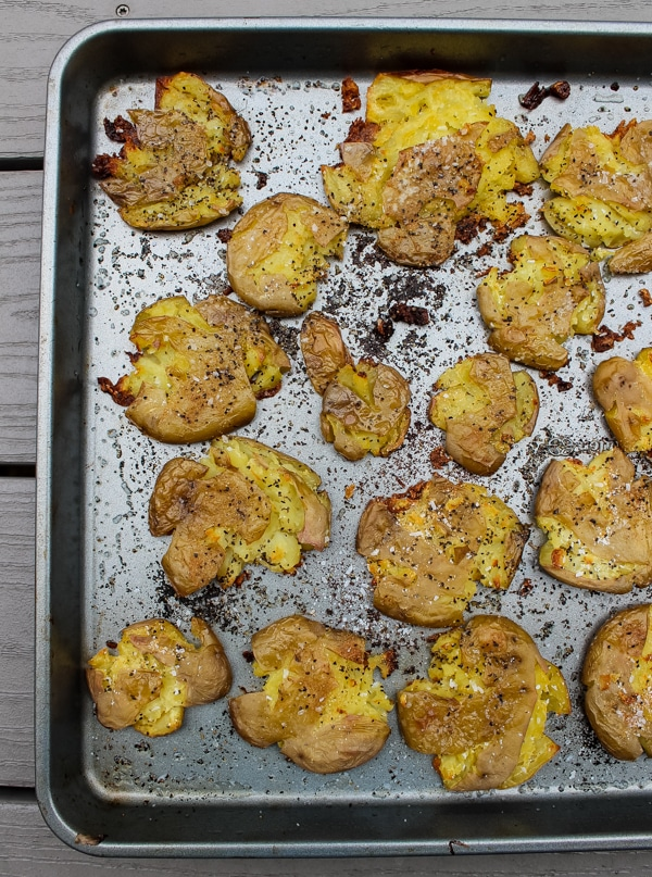 Crispy smashed dutch potatoes on a baking sheet, fresh from the oven.