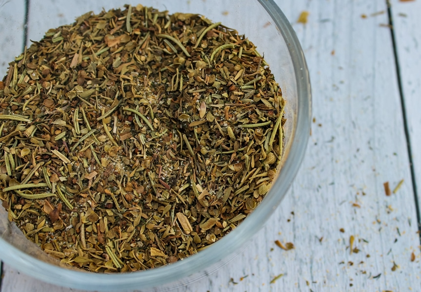 overhead view of a clear bowl of Greek Seasoning Spice Blend set against a white background