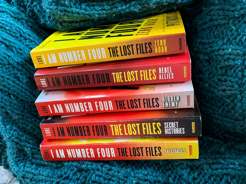 picture of the 5 books (15 novellas) in The Lorien Legacies The Legacies series by Pittacus Lore