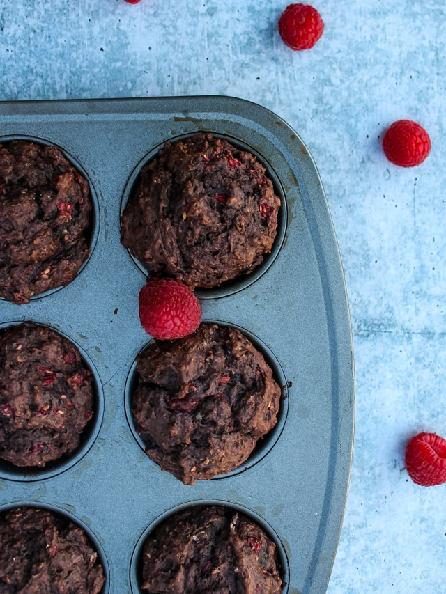 overhead shot of chocolate raspberry muffins in a muffin pan