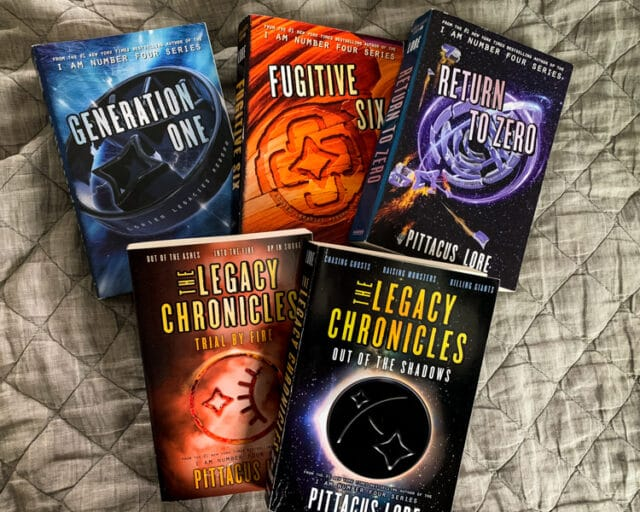 overhead view of the books in the Lorien Legacies: Reborn and The Legacy Chronicles series
