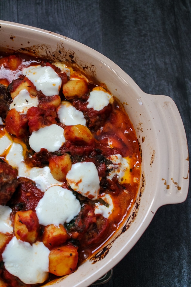 Overhead view of a baking dish filled with Italian Meatball Gnocchi Bake