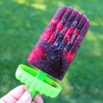 sangria popsicle against a green backdrop