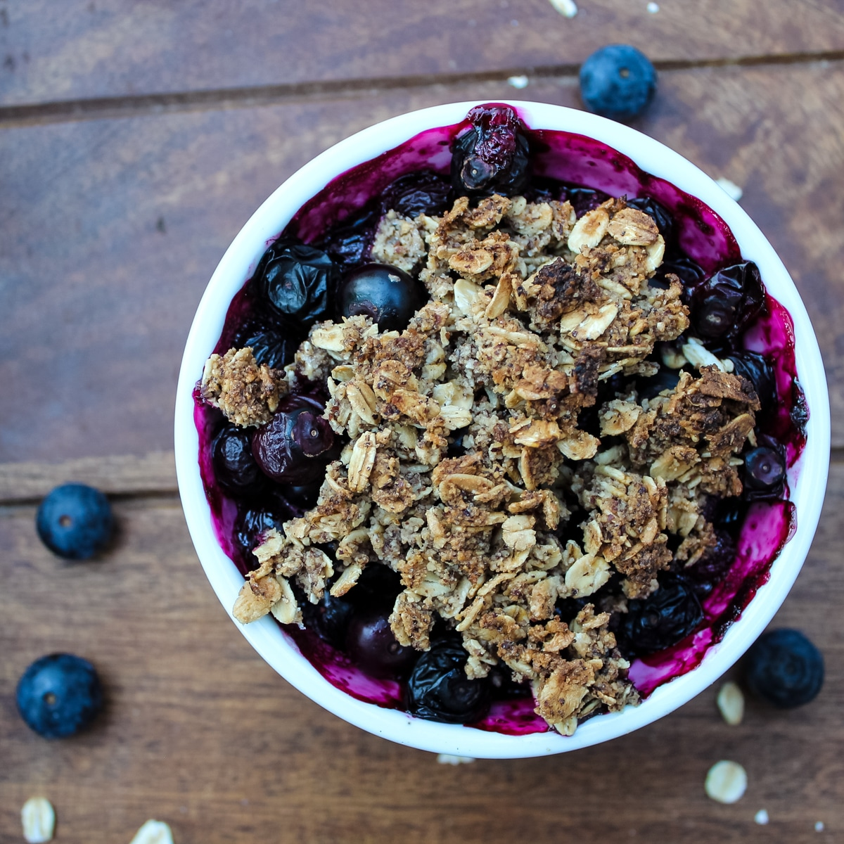White ramekin of Blueberry Crisp with a crumble topping