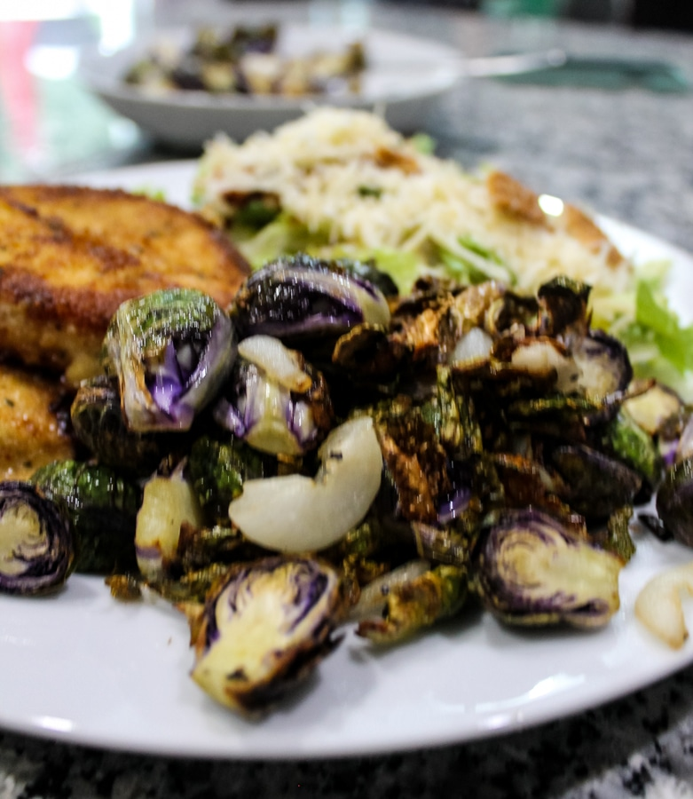"""overhead view of Air Fryer """"Roasted"""" Brussels Sprouts on a dinner plate"""