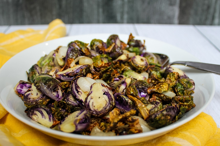 """side view of a bowl of Air Fryer """"Roasted"""" Brussels Sprouts"""